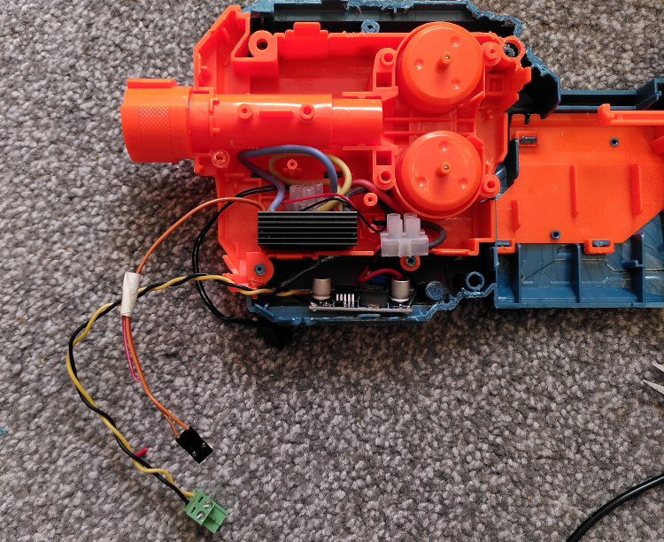 Modified Nerf gun insides with a speed controller and voltage regulator