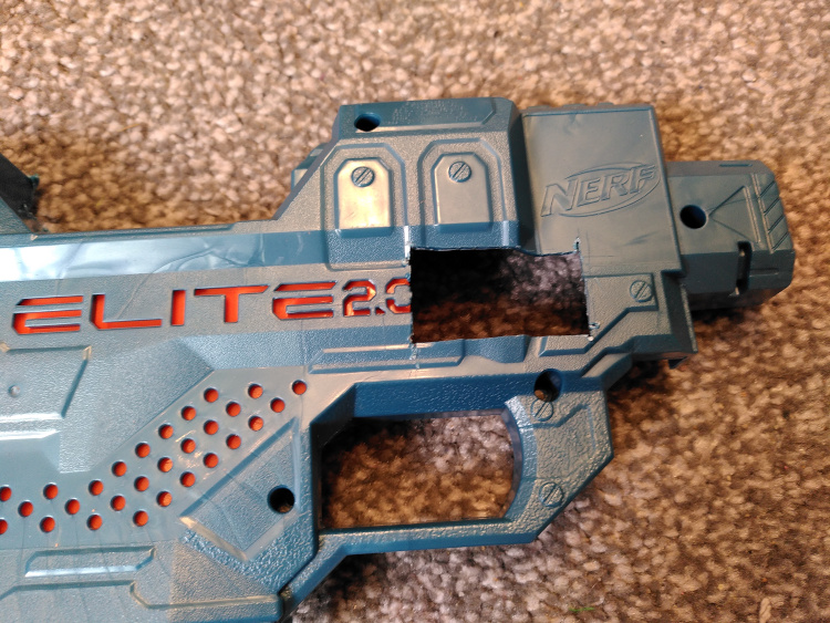 Rectangular hole cut in the side of a Nerf gun