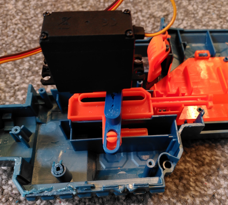 Servo mounted inside a Nerf gun where the trigger used to be